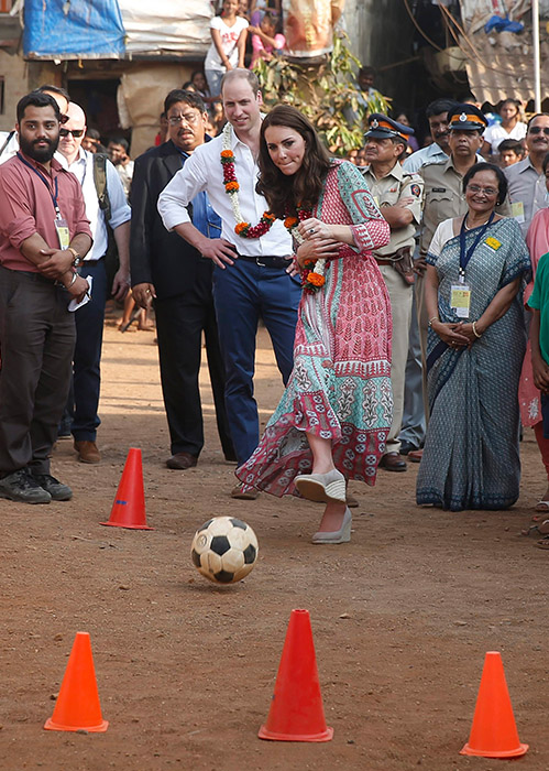 <div class='meta'><div class='origin-logo' data-origin='AP'></div><span class='caption-text' data-credit='Shailesh Andrade /Pool via AP'>Prince William, watches as his wife Kate, the Duchess of Cambridge, plays soccer during their visit to a slum in Mumbai, India, Sunday, April 10, 2016.</span></div>