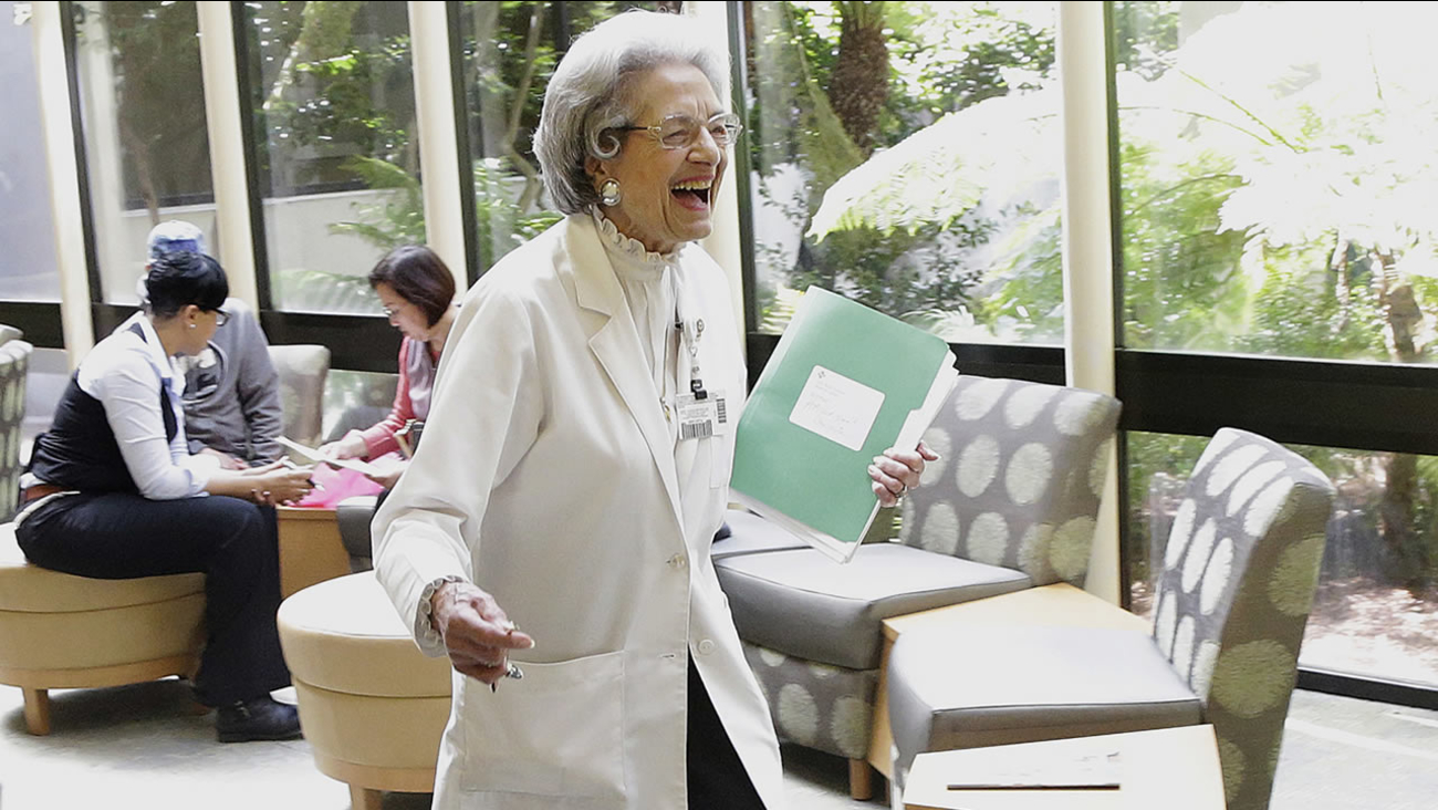 Patient relations representative Elena Griffing smiles while walking in the lobby at Sutter Health Alta Bates Summit Medical Center in Berkeley, Calif., Monday, April 11, 2016. (AP Photo/Jeff Chiu)