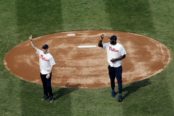 """<div class=""""meta image-caption""""><div class=""""origin-logo origin-image ap""""><span>AP</span></div><span class=""""caption-text"""">Villanova's Ryan Arcidiacono, left, and Daniel Ochefu, gesture to fans before throwing out ceremonial pitches ahead of the Philadelphia Phillies' home opening day baseball game. (AP Photo/Matt Rourke)</span></div>"""