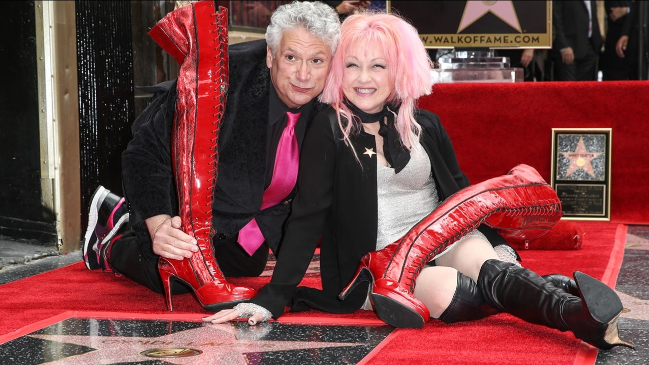 Harvey Fierstein, left, and Cyndi Lauper attend a ceremony honoring them with stars on the Hollywood Walk of Fame on Monday, April 11, 2016, in Los Angeles.