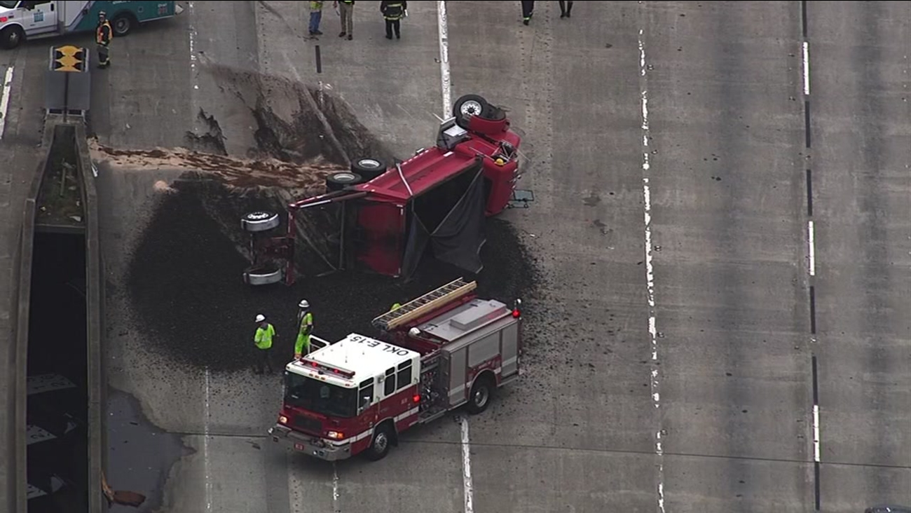 An overturned dump truck blocked 2 lanes of southbound I-880 at Jackson Street in Oakland, Calif. on Tuesday, April 12, 2016.