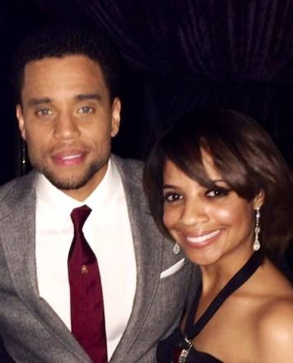 <div class='meta'><div class='origin-logo' data-origin='none'></div><span class='caption-text' data-credit=''>Taylor with actor Michael Ealy</span></div>
