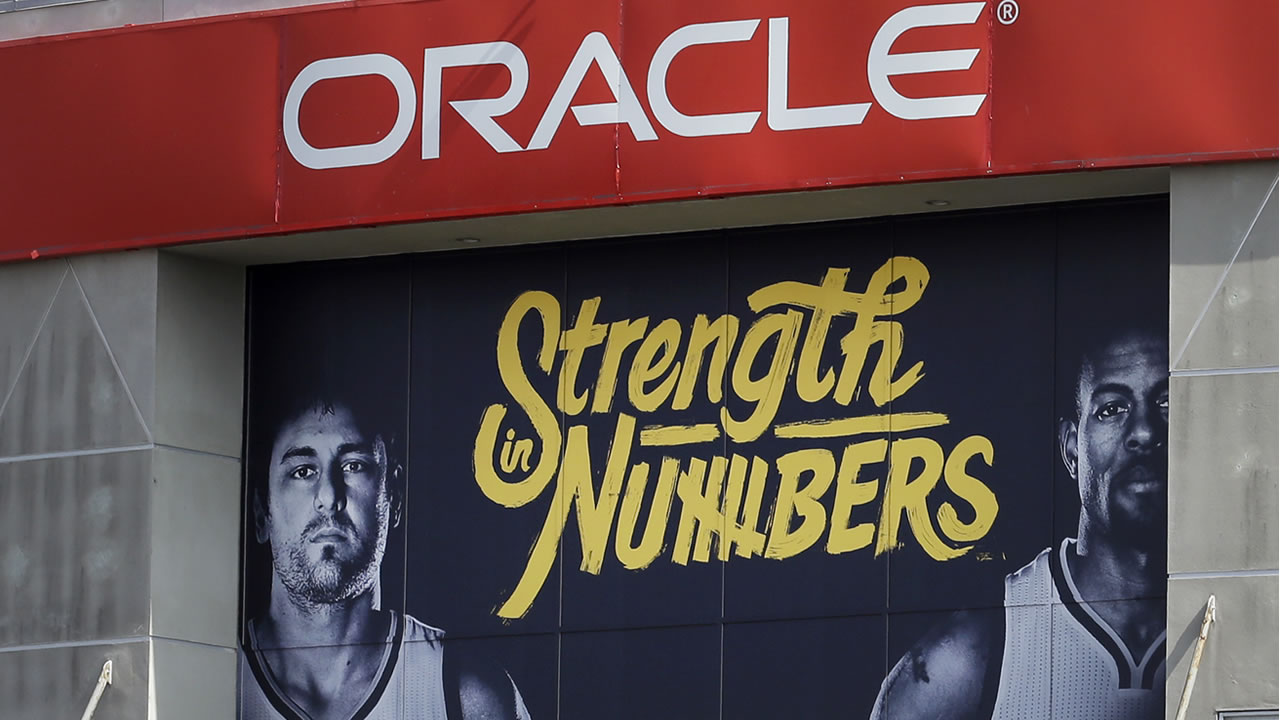 The Golden State Warriors have installed the team's 2016 [layoff signage, using the Strength in Numbers slogan seen on Oracle Arena on Tuesday, April 12, 2016, in Oakland, Calif. (AP Photo/Ben Margot)