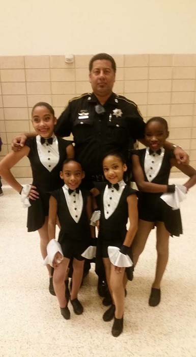 "<div class=""meta image-caption""><div class=""origin-logo origin-image ktrk""><span>KTRK</span></div><span class=""caption-text"">Deputy Constable Alden Clopton and his daughters (KTRK)</span></div>"