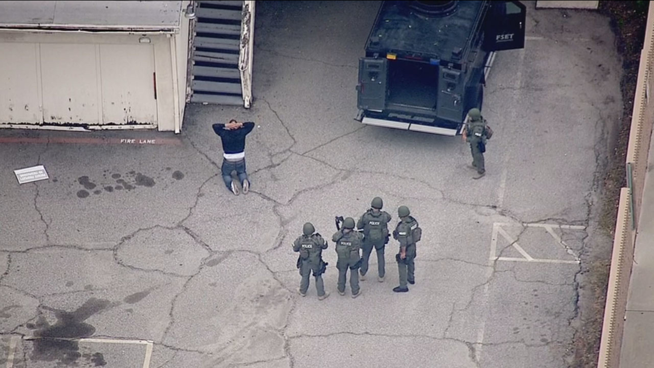 A burglary suspect is taken into custody by officers in Glendora on Thursday, April 14, 2016.