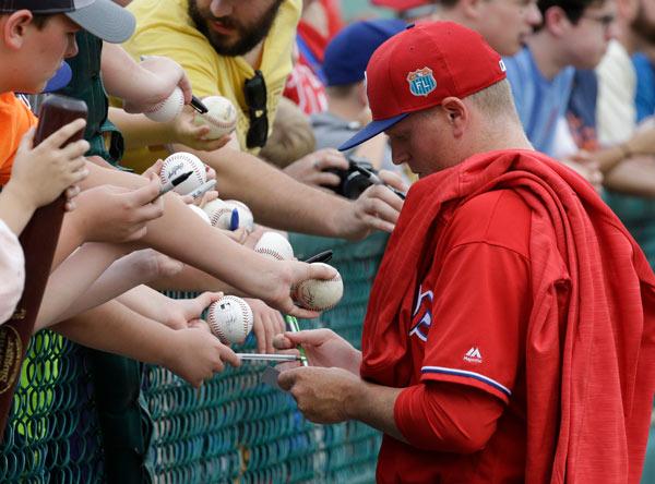 "<div class=""meta image-caption""><div class=""origin-logo origin-image ap""><span>AP</span></div><span class=""caption-text"">Philadelphia Phillies' Daniel Stumpf, right, signs autographs for fans at a spring training baseball game against the Atlanta Braves, Thursday, March 24, 2016, in Kissimmee, Fla. (AP Photo/John Raoux)</span></div>"