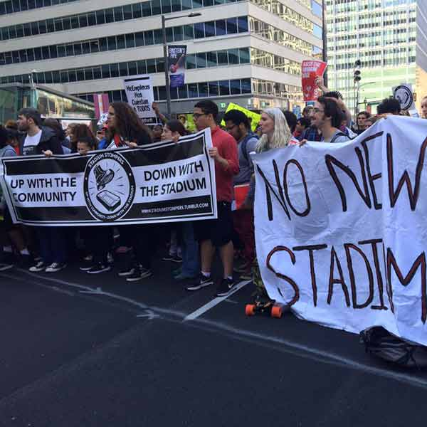 """<div class=""""meta image-caption""""><div class=""""origin-logo origin-image none""""><span>none</span></div><span class=""""caption-text"""">Protestors blasting Temple University for claiming it can't pay workers $15 then spending millions on new stadium.</span></div>"""