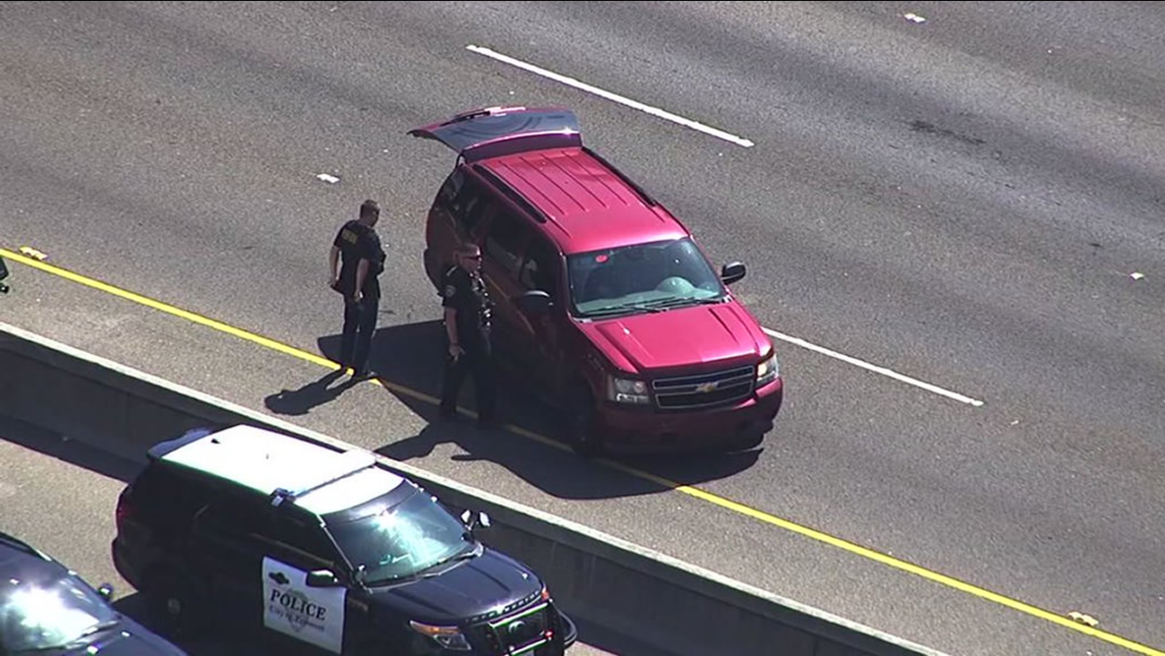 This image shows California Highway Patrol officers investigating an incident on Interstate 880 in Fremont that prompted all lanes to closed at Thornton Avenue April 14, 2016.