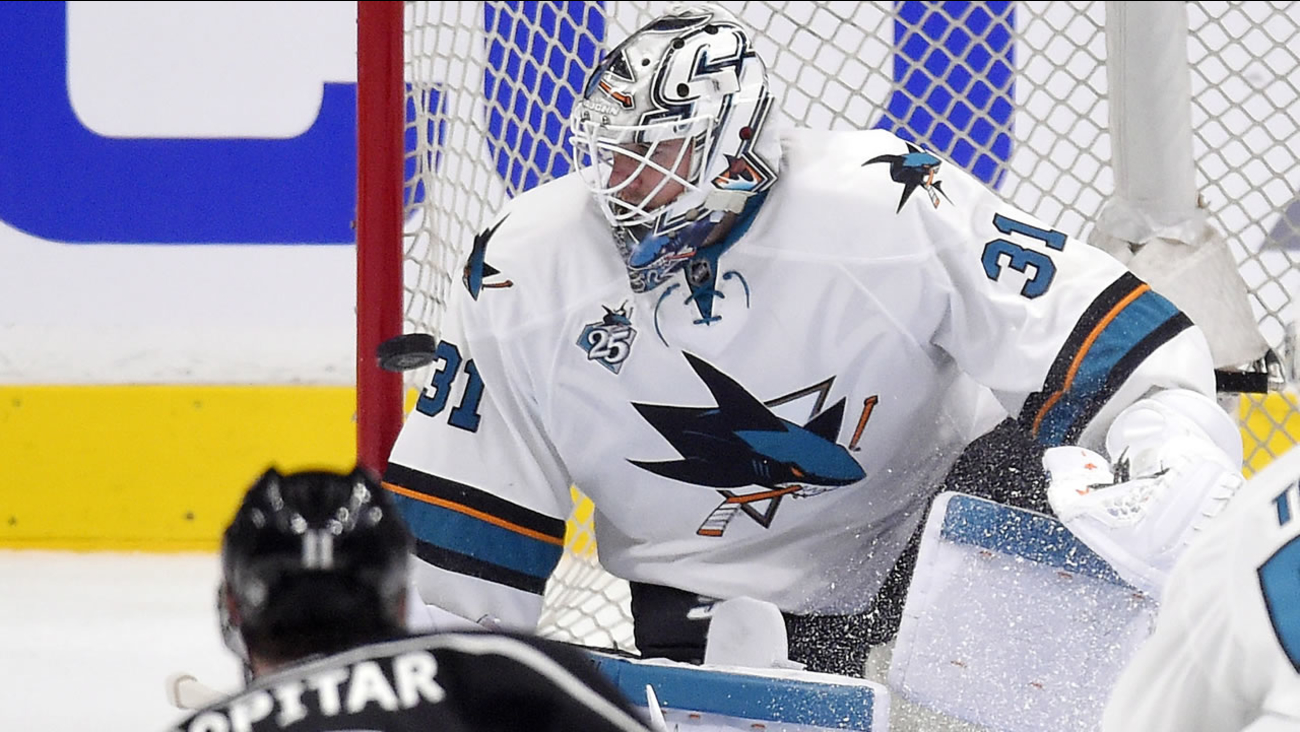 San Jose Sharks goalie Martin Jones is scored on by Los Angeles Kings center Trevor Lewis during a hockey Stanley Cup playoffs first-round series April 14, 2016, in Los Angeles.
