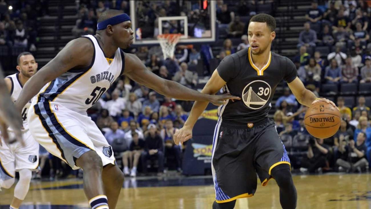 Warriors' Stephen Curry controls the ball against Memphis Grizzlies forward Zach Randolph in the first half of an NBA basketball game Saturday, April 9, 2016, in Memphis, Tenn.