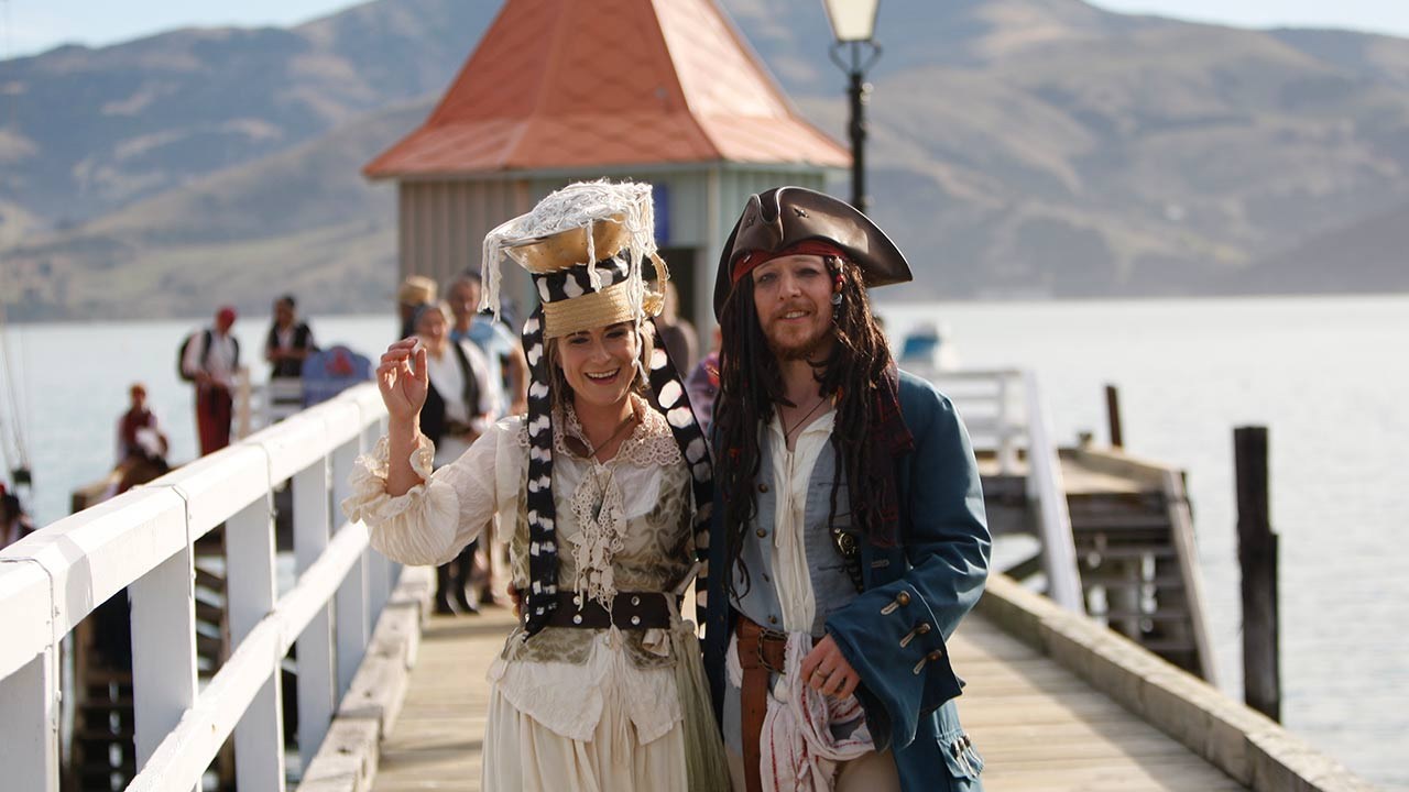 Bride Marianna Fenn and bridegroom Toby Ricketts stand on a jetty in Akaroa harbor, New Zealand, Saturday April 16, 2016. New Zealand hosted the world's first Pastafarian wedding.