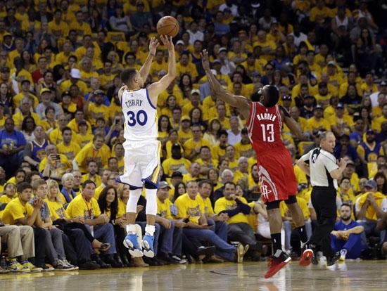 "<div class=""meta image-caption""><div class=""origin-logo origin-image ap""><span>AP</span></div><span class=""caption-text"">Golden State Warriors' Stephen Curry (30) makes a 3-point basket over Houston Rockets' James Harden (13) during the first half. (Marcio Jose Sanchez)</span></div>"