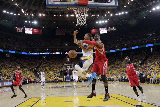 "<div class=""meta image-caption""><div class=""origin-logo origin-image ap""><span>AP</span></div><span class=""caption-text"">Houston Rockets' Dwight Howard, center, right, blocks a shot attempt from Golden State Warriors' Stephen Curry, center left, during the first half. (Marcio Jose Sanchez)</span></div>"