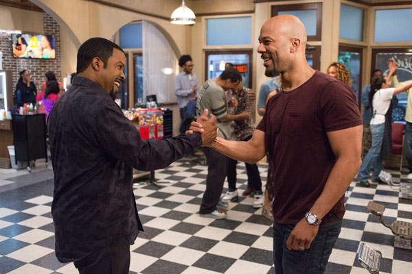 """<div class=""""meta image-caption""""><div class=""""origin-logo origin-image ap""""><span>AP</span></div><span class=""""caption-text"""">In this image released by Warner Bros., Ice Cube, left, and Common appear in a scene from """"Barbershop: The Next Cut."""" (Chuck Zlotnick/Warner Bros. via AP)</span></div>"""