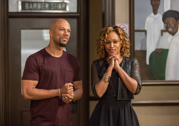 """<div class=""""meta image-caption""""><div class=""""origin-logo origin-image ap""""><span>AP</span></div><span class=""""caption-text"""">In this image released by Warner Bros., Common, left, and Eve appear in a scene from """"Barbershop: The Next Cut."""" (Chuck Zlotnick/Warner Bros. via AP)</span></div>"""