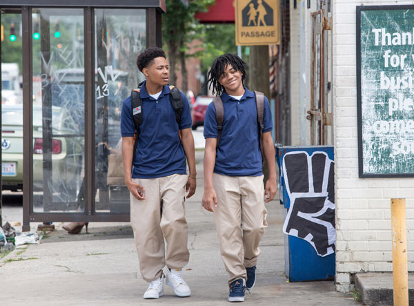 """<div class=""""meta image-caption""""><div class=""""origin-logo origin-image ap""""><span>AP</span></div><span class=""""caption-text"""">In this image released by Warner Bros., Diallo Thompson, left, and Michael Rainey Jr. appear in a scene from """"Barbershop: The Next Cut."""" (Chuck Zlotnick/Warner Bros. via AP)</span></div>"""