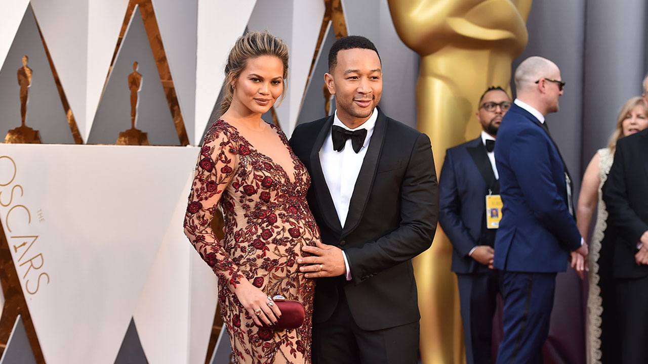 Chrissy Teigen, left, and John Legend arrive at the Oscars on Sunday, Feb. 28, 2016, at the Dolby Theatre in Los Angeles.