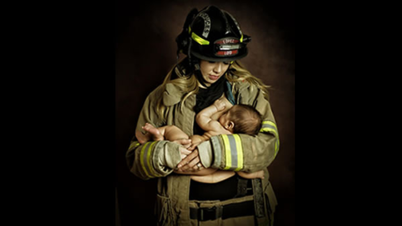 A New Mexico firefighter is in hot water over a photograph of his wife that shows her breastfeeding their newborn in his firefighting uniform.