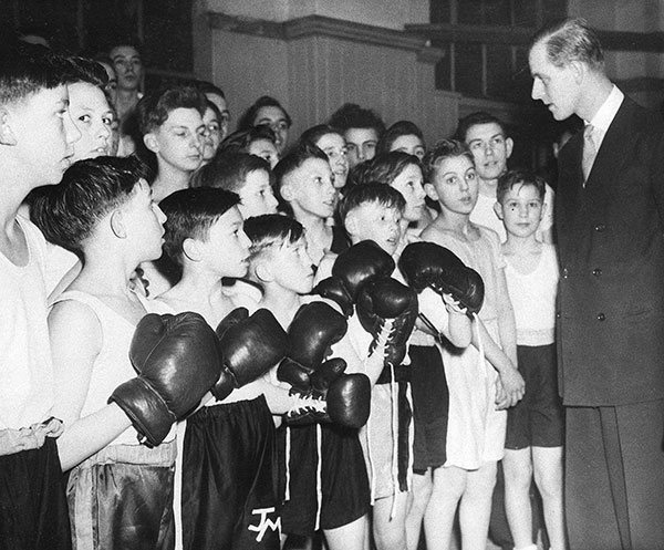 "<div class=""meta image-caption""><div class=""origin-logo origin-image none""><span>none</span></div><span class=""caption-text"">Prince Philip, the Duke of Edinburgh, right, hands out advice before bouts in a boys' boxing tournament in London in 1949. (AP Photo)</span></div>"