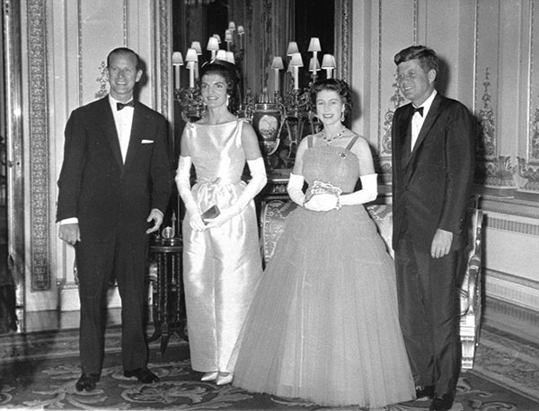 "<div class=""meta image-caption""><div class=""origin-logo origin-image none""><span>none</span></div><span class=""caption-text"">Queen Elizabeth II poses with U.S. President John F. Kennedy at Buckingham Palace in 1961. Also seen are Prince Philip, left, and first lady Jackie Kennedy. (AP Photo/Pool)</span></div>"