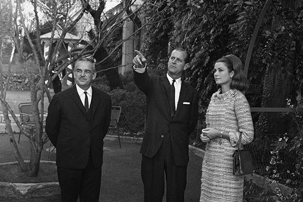 "<div class=""meta image-caption""><div class=""origin-logo origin-image none""><span>none</span></div><span class=""caption-text"">Prince Philip of Great Britain points as he tours the Monaco Palace gardens on Dec. 11, 1966 with Princess Grace of Monaco and Prince Rainer, at left. (AP Photo)</span></div>"