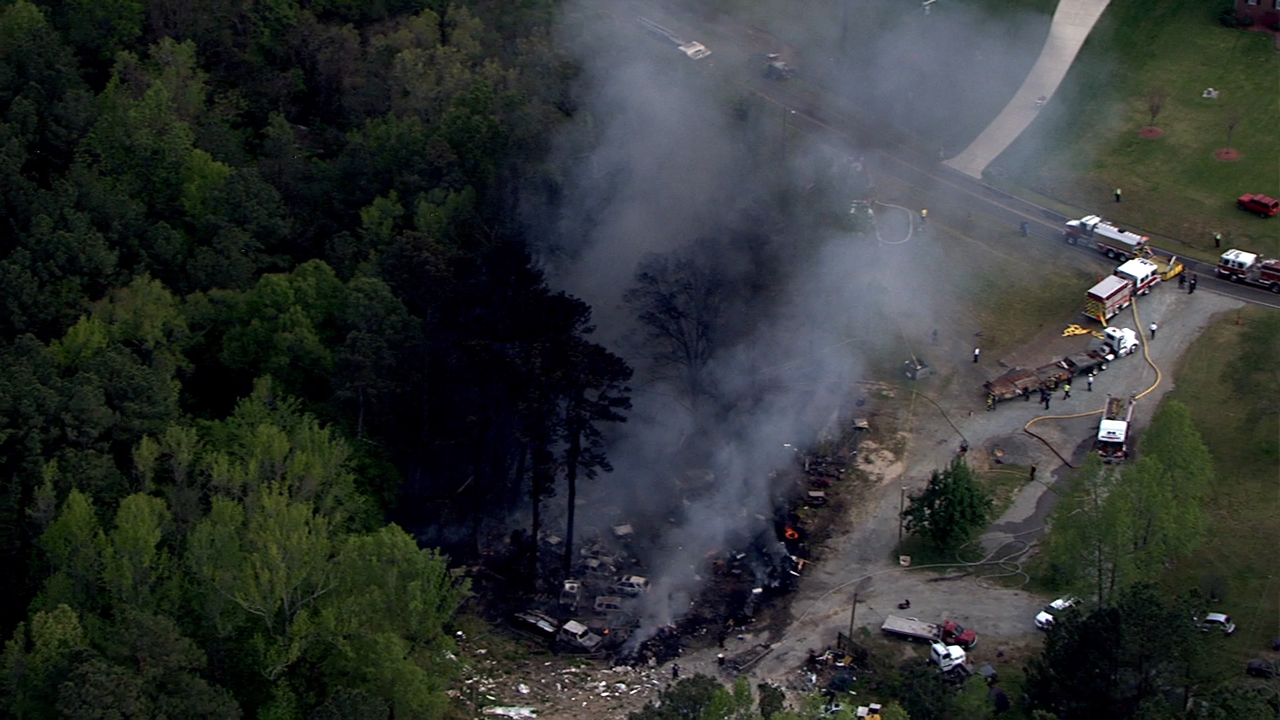 Large junk yard fire sends thick smoke over northern ...