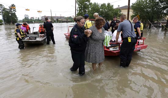 <div class='meta'><div class='origin-logo' data-origin='none'></div><span class='caption-text' data-credit='AP'>Residents are evacuated from their flooded apartment complex</span></div>