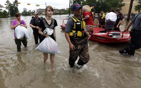 "<div class=""meta image-caption""><div class=""origin-logo origin-image ap""><span>AP</span></div><span class=""caption-text"">Residents are evacuated from their flooded apartment complex Tuesday, April 19, 2016, in Houston (AP Photo/David J. Phillip)</span></div>"