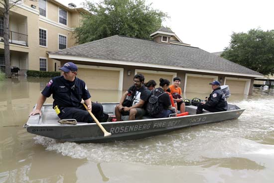 "<div class=""meta image-caption""><div class=""origin-logo origin-image ap""><span>AP</span></div><span class=""caption-text"">Residents are evacuated from their flooded apartment complex Tuesday, April 19, 2016. (AP Photo/David J. Phillip)</span></div>"