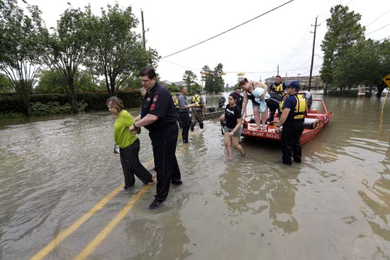 "<div class=""meta image-caption""><div class=""origin-logo origin-image ap""><span>AP</span></div><span class=""caption-text"">Residents are helped off rescue boats after being evacuated from their flooded apartment complex Tuesday, April 19, 2016 (AP Photo/David J. Phillip)</span></div>"