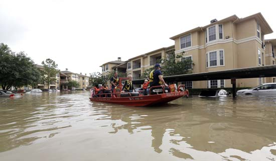 <div class='meta'><div class='origin-logo' data-origin='AP'></div><span class='caption-text' data-credit='AP Photo/David J. Phillip'>Residents are evacuated from their flooded apartment complex Tuesday, April 19, 2016</span></div>