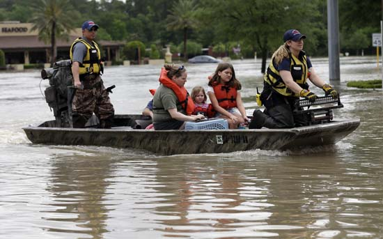 "<div class=""meta image-caption""><div class=""origin-logo origin-image ap""><span>AP</span></div><span class=""caption-text"">Residents are evacuated from their flooded apartment complex (AP Photo/David J. Phillip)</span></div>"
