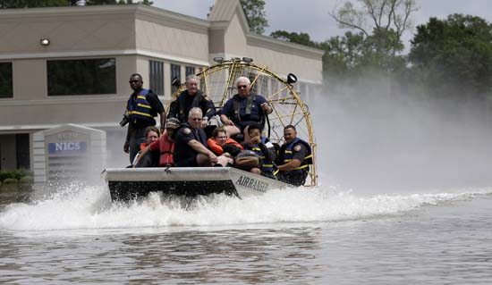 <div class='meta'><div class='origin-logo' data-origin='AP'></div><span class='caption-text' data-credit='AP Photo/David J. Phillip'>Residents are evacuated by airboat from their flooded neighborhood</span></div>