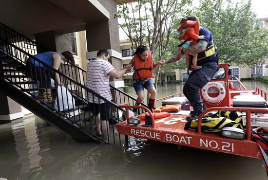 <div class='meta'><div class='origin-logo' data-origin='AP'></div><span class='caption-text' data-credit='AP Photo/David J. Phillip'>Residents are evacuated from their flooded apartment complex</span></div>
