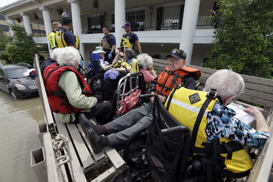 <div class='meta'><div class='origin-logo' data-origin='AP'></div><span class='caption-text' data-credit='AP Photo/David J. Phillip'>Residents of a retirement and assisted living complex are evacuated</span></div>