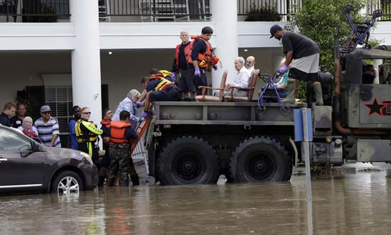 "<div class=""meta image-caption""><div class=""origin-logo origin-image ap""><span>AP</span></div><span class=""caption-text"">Residents are evacuated from a retirement and assisted living complex as floodwaters rise (AP Photo/David J. Phillip)</span></div>"