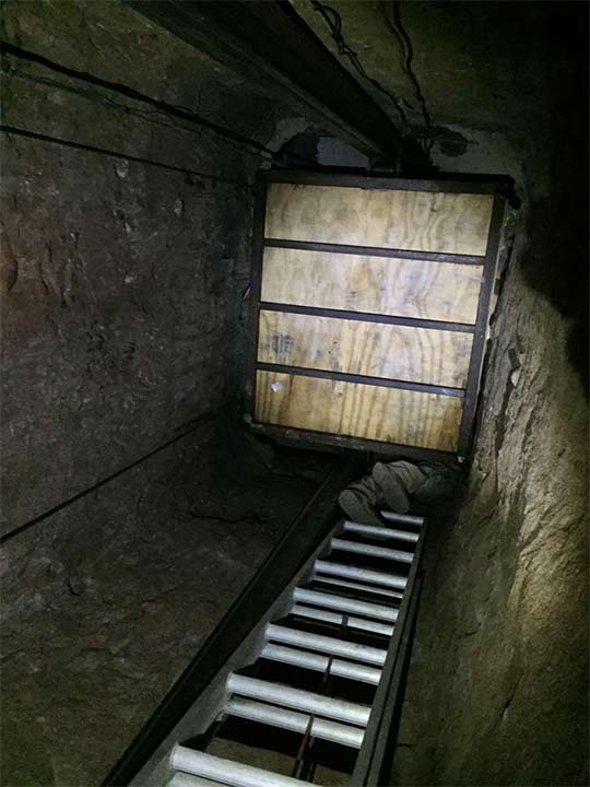<div class='meta'><div class='origin-logo' data-origin='none'></div><span class='caption-text' data-credit='United States Department of Justice'>A large, commercial-grade elevator was found inside the tunnel. It led to a closet inside a home in Tijuana.</span></div>