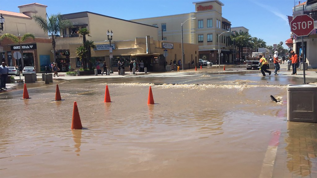 A water main break sent muddy water down Main Street in Huntington Beach Wednesday, April 20, 2016.