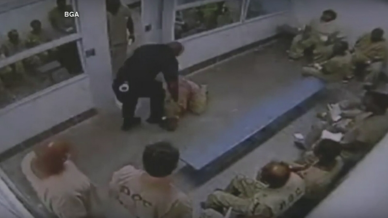 Video shows jail guard punching inmate