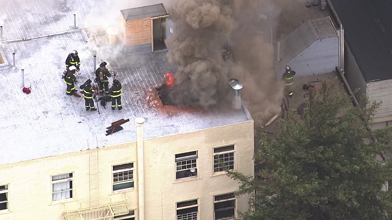 Firefighters battle a three-alarm fire at 17th and Guerrero in San Francisco on Thursday, April 21, 2016.