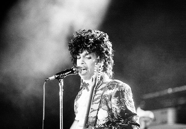 <div class='meta'><div class='origin-logo' data-origin='none'></div><span class='caption-text' data-credit='Phil Sandlin/AP Photo'>Rock singer Prince performs at the Orange Bowl during his Purple Rain tour in Miami, Fla., April 7, 1985.</span></div>