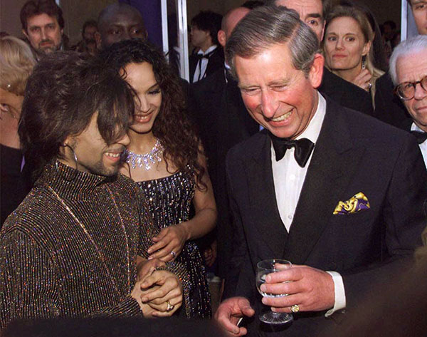 <div class='meta'><div class='origin-logo' data-origin='none'></div><span class='caption-text' data-credit='Dave Hogan/pool/AP Photo'>Britain's Prince Charles talks with The Artist, formerly known as Prince, left, and his wife Mayte Garcia at the &#34;Diamonds are Forever&#34; celebration in London in June 1999.</span></div>