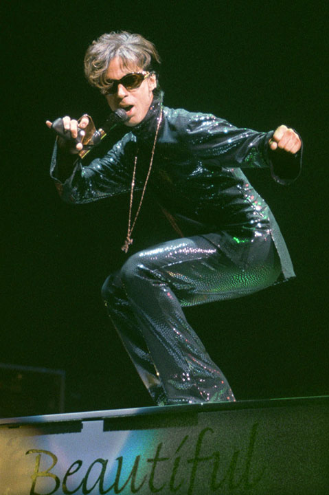 "<div class=""meta image-caption""><div class=""origin-logo origin-image none""><span>none</span></div><span class=""caption-text"">The Artist, formerly known as Prince, performs at the Festhalle in Frankfurt, Germany during a tour in Dec. 1998. (Bernd Kammerer/AP Photo)</span></div>"