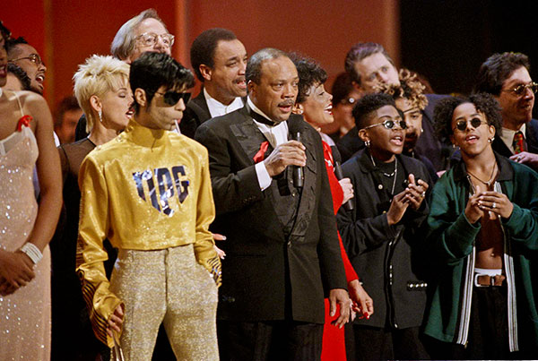 <div class='meta'><div class='origin-logo' data-origin='none'></div><span class='caption-text' data-credit='Reed Saxon/AP Photo'>Prince is surrounded by dozens of singers performing ''We Are The World'' for the 10th anniversary of the African famine relief anthem at the 1995 American Music Awards.</span></div>