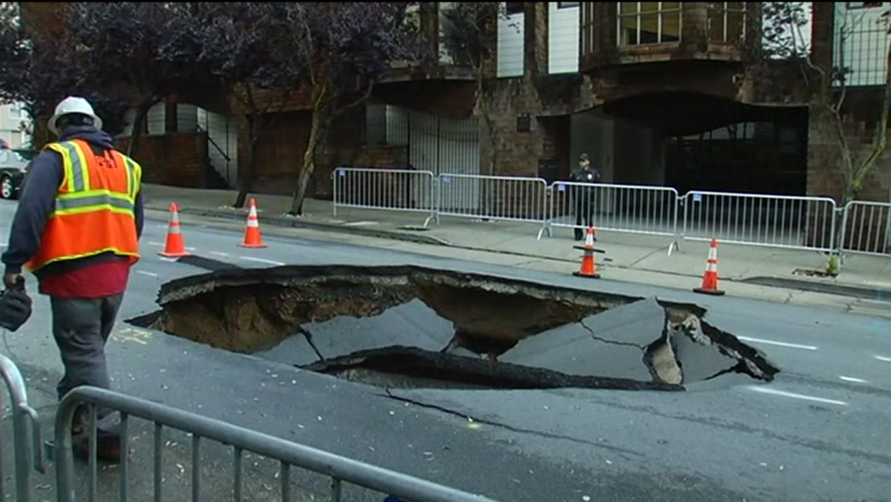 Repairs are underway in San Francisco to fill in a giant sinkhole in the city's Presidio Heights neighborhood on Friday, April 22, 2016.