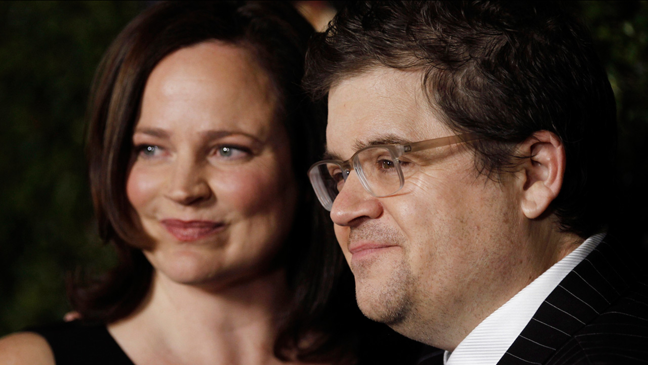 "Patton Oswalt, right, and Michelle Eileen McNamara arrive at the premiere of ""Young Adult"" in Beverly Hills, Calif., Thursday, Dec. 15, 2011."