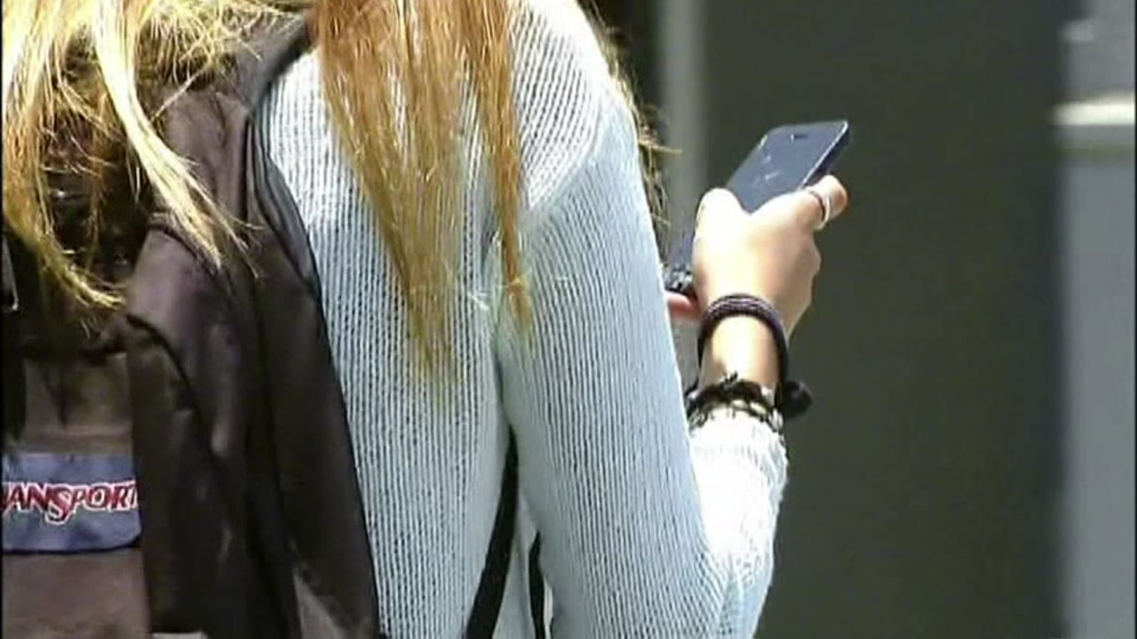 Sexting - Student on Cell Phone - Smartphone