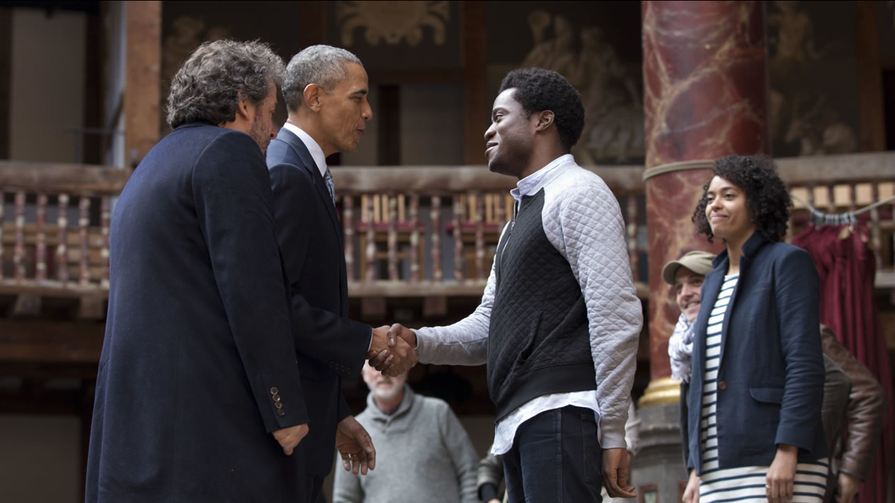 President Barack Obama, 2nd left, greets actors on stage after watching them perform Shakespeare's Hamlet at the Globe Theatre in London, Saturday, April 23, 2016.