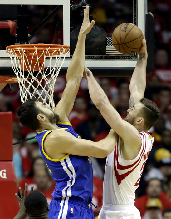 """<div class=""""meta image-caption""""><div class=""""origin-logo origin-image ap""""><span>AP</span></div><span class=""""caption-text"""">Houston Rockets' Donatas Motiejunas, right, heads to the basket as Golden State Warriors' Andrew Bogut defends during the first half. (David J. Phillip)</span></div>"""