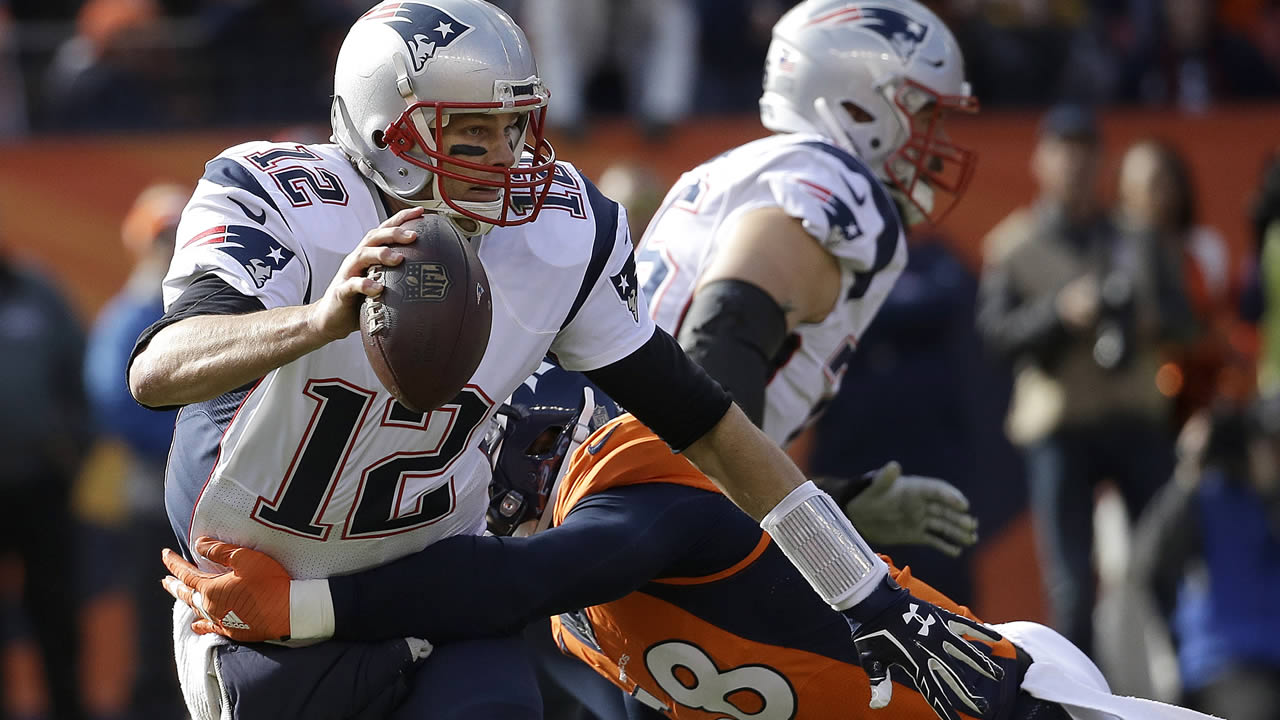 Patriots' Tom Brady is tackled by Broncos' Von Miller during the NFL football AFC Championship game between the Broncos and Patriots, Sunday, Jan. 24, 2016, in Denver. (AP Photo)